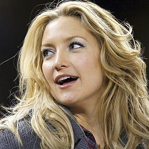 Actress Kate Hudson watches the MLB American League Division Series playoff baseball game between the New York Yankees and Minnesota Twins in New York