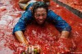 عکسهای جشن پرتاب گوجه در اسپانیا