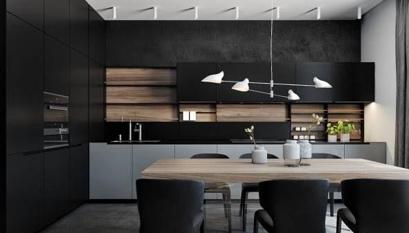 طراحی داخلی آشپزخانه با کابینت مشکی و تزیین طلایی لوکس
